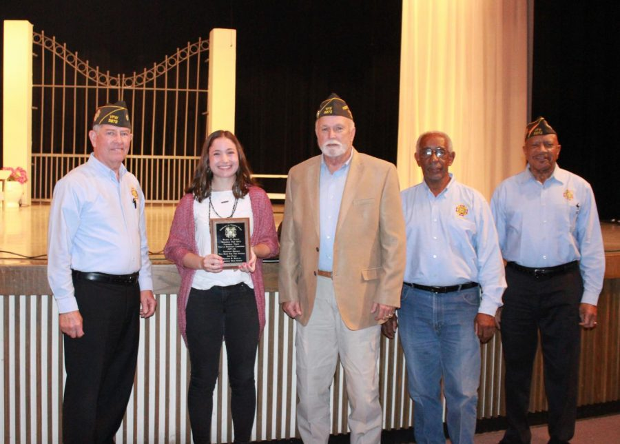 Members+of+the+VFW+present+Rebecca+Dunlap+with+an+award+and+%24150+for+her+speech.