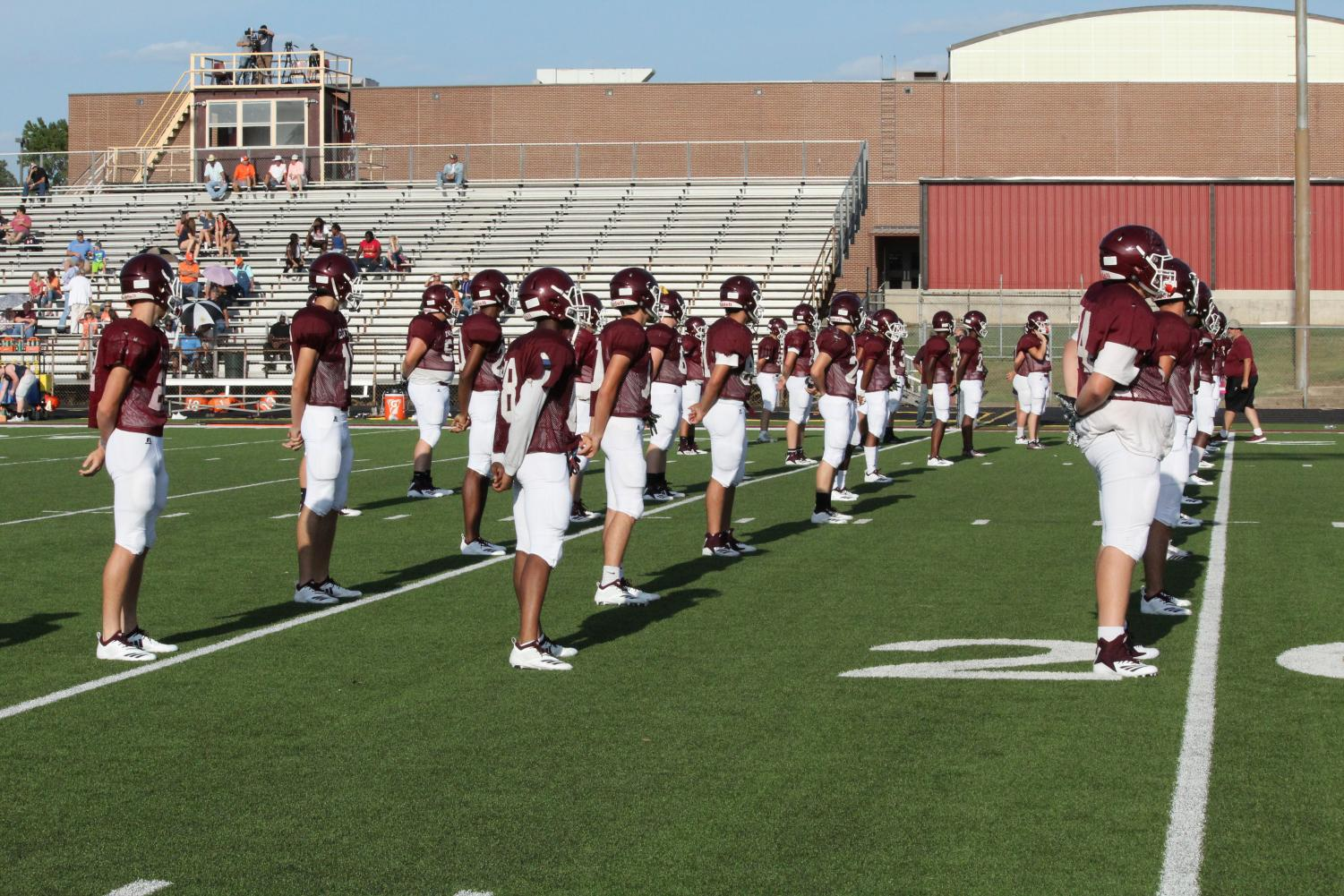 The Varsity football team lines up to begin warm-ups at the scrimmage against Teague on August 17. Photo by Morgan Coleman.