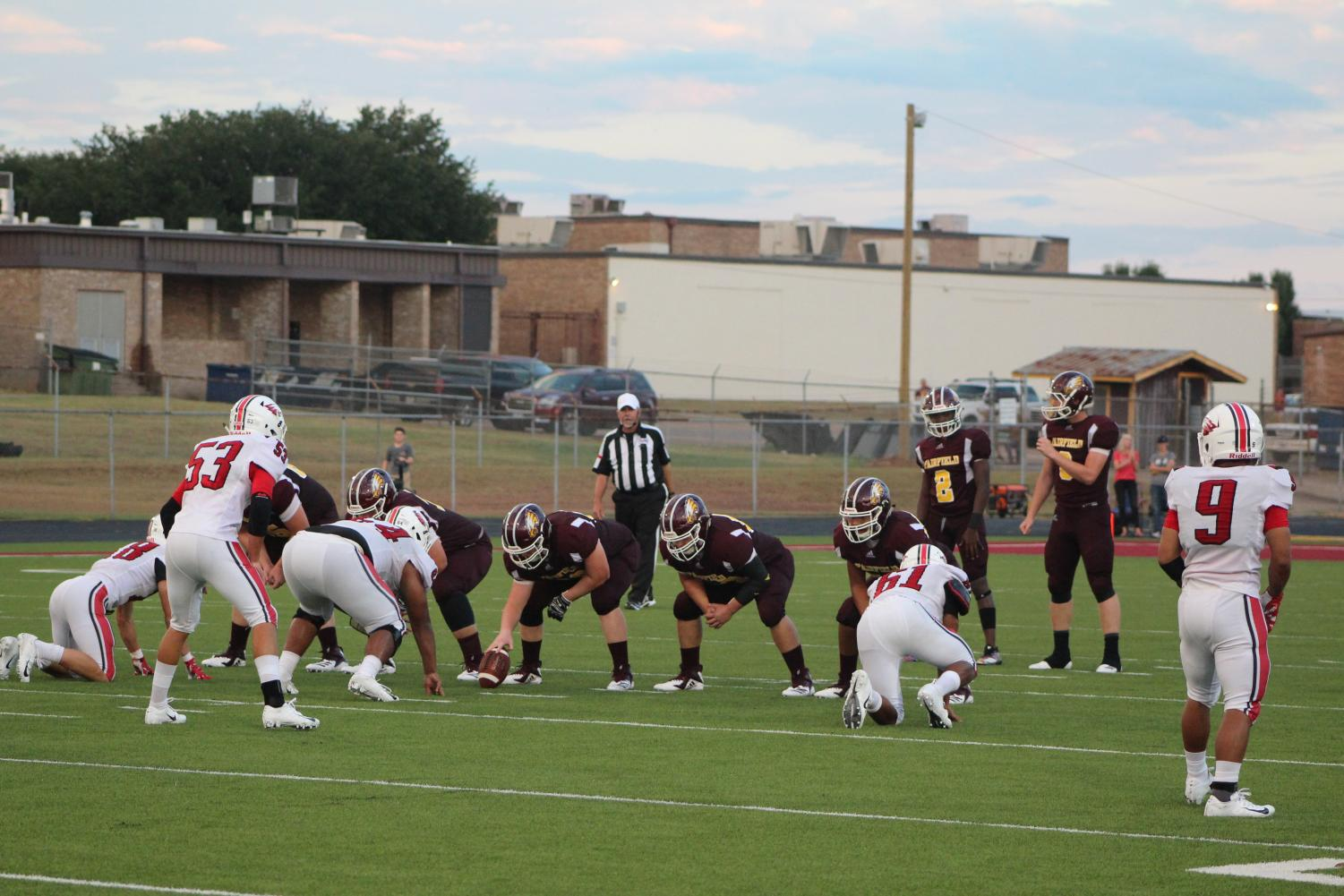 The offensive line, #2 Kadarrius Walker, and #8 Chad Rushin prepare for the snap. Photo by Melanie Pina.