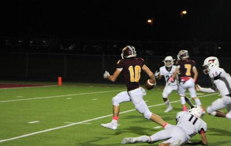 Senior Blake Posey breaks from a tackle attempt by Madisonville and scores at the Pink-Out game Oct. 5 at Eagle Field.