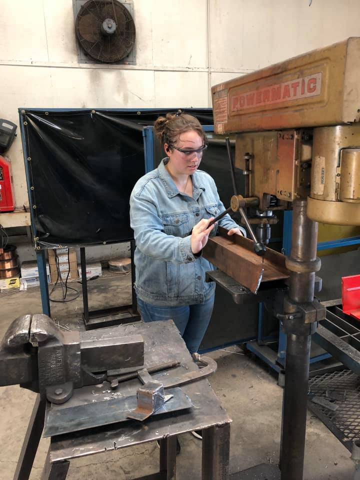 Junior Madison Thaler uses  a machine to help build the trailer. Photo contributed by Fairfield FFA Chapter