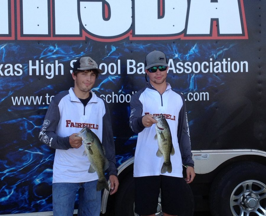 Seniors+Hayden+Hardwick+and+Payton+Hughes+hold+up+their+catch+at+the+THSBA+fishing+tournament.+Photo+contributed+by+Dr.+Adams.