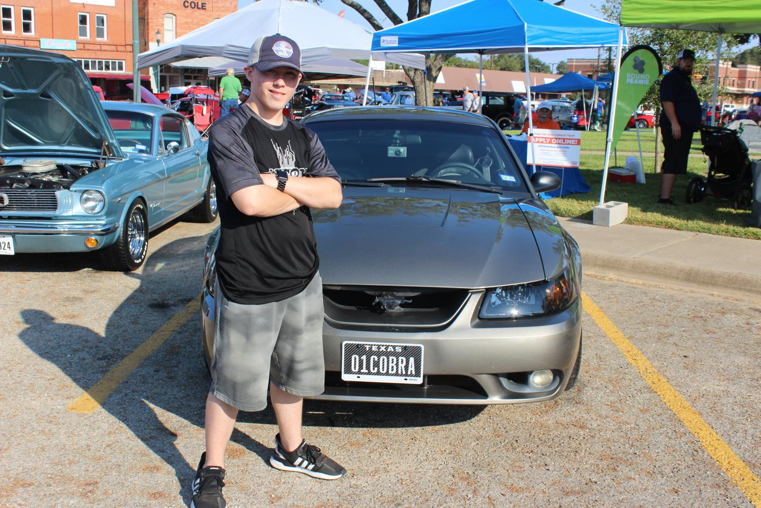 Senior Kaleb Shoemaker stands next to his '01 Cobra. Photo by Isabel Growden.