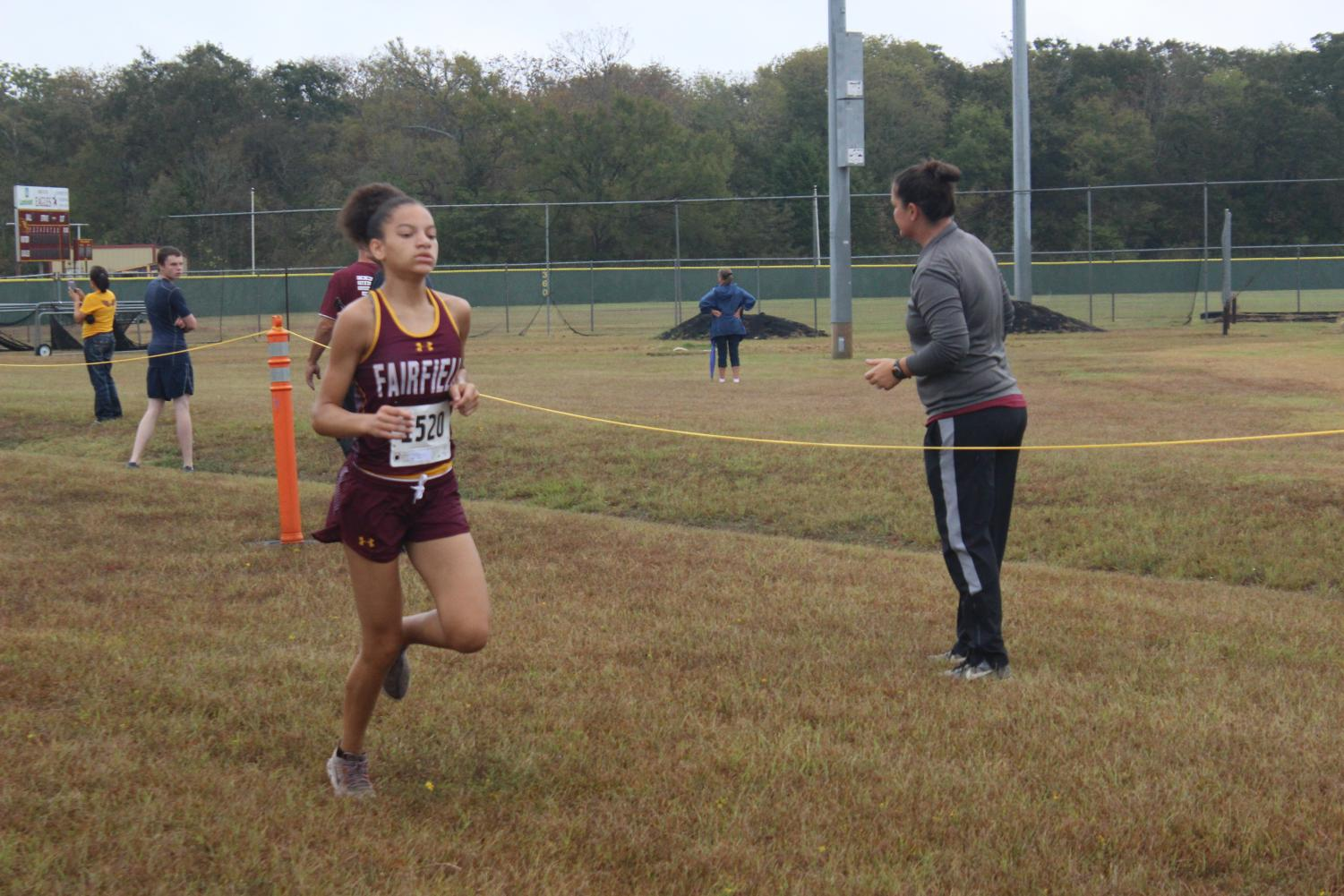 Sophomore Jarahle Daniels finishes first in the girls district meet, advancing to regional. Photo by Hailey Lane.