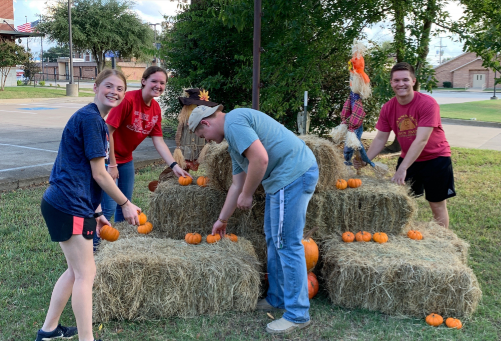 Beta Club Members help set up the decorations at the Pumpkin Patch. Pictured left to right: junior Erica McQuinn, seniors Kailee Marchand, Drew Williams, and David Thomas. Photo contributed by Beta Club.