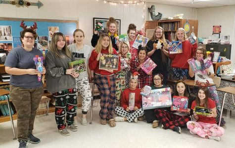 Newspaper, yearbook, and journalism classes collected 22 toys for Blue Santa. Photo contributed by Kathie Maciel.