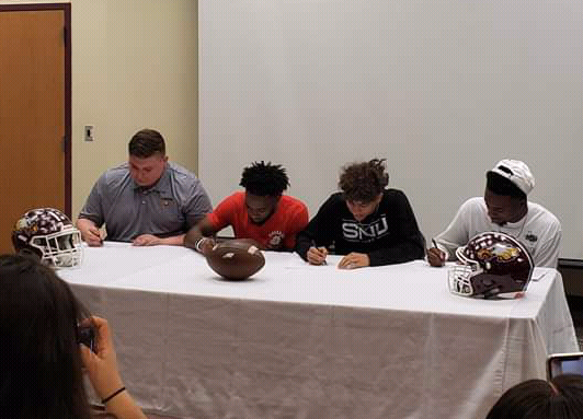 Seniors Chandler Noble, JarMycheal Hudson, DeQuann McWilliams, and Justin Abram sign to their schools. Photo contributed by FISD.