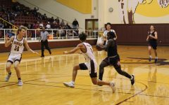 Senior DeQuann McWilliams  guards opponent from Madisonville. Photo by Hailey Lane.