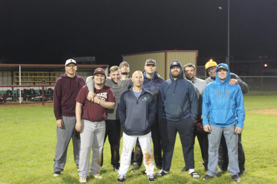 The+alumni+team+with+head+coach+Bill+Crawford.+Photo+Erin+Rachel.