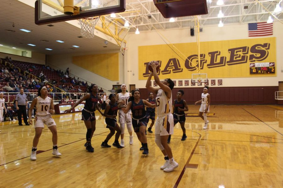 Lady Eagles Shoot to End as First in District