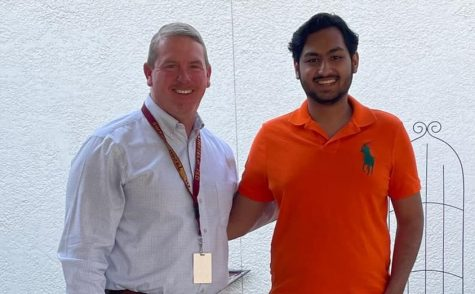 Walia pictured with Superintendent Jason Adams.