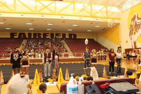 The senior Homecoming queen nominees and their escorts are introduced at the pep rally.