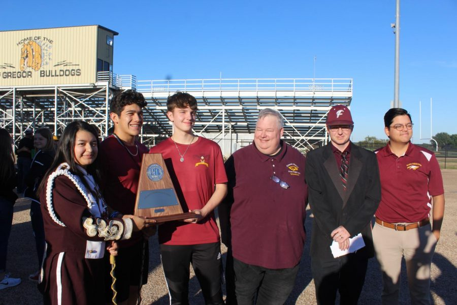 Band Director Russell Holland receives the advancing award for UIL district marching. The Grand Band will compete in area on October 23 at Robinson High School. Pictured with Holland are senior Yadira Yepez, senior Nicolas Martinez, senior Mason Wright, assistant band director Gust Witt, Holland, assistant band director Adan Coronado.